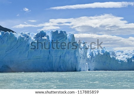 blue ice mountains of the magnificent Perito Moreno glacier, Patagonia, Argentina - stock photo