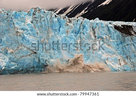 Blue ice of the Child's lacier calving into the Copper River near Cordova, Alaska