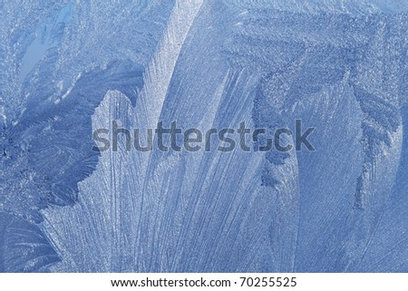 blue ice pattern on winter glass - stock photo