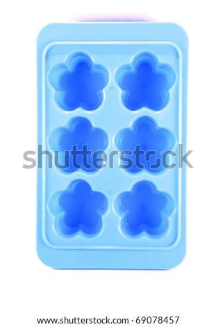 Blue ice tray flower shape isolated on white background - stock photo