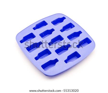 Blue ice tray isolated on white background - stock photo