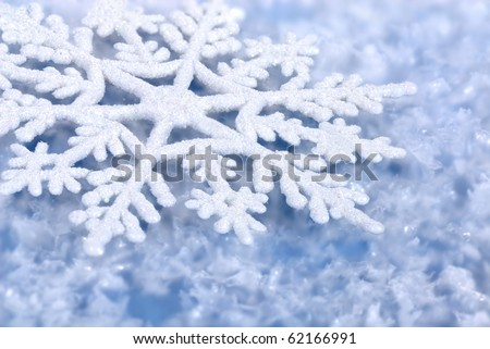 Blue icy background with snowflakes, perfect for Christmas and winter - stock photo