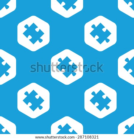 Blue image of puzzle piece in white hexagon, repeated on blue - stock photo