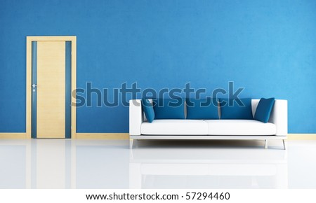 blue interior with modern couch and wooden door - stock photo