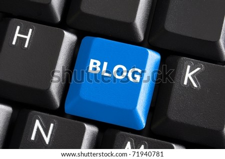 blue internet blog concept with button on computer keyboard - stock photo