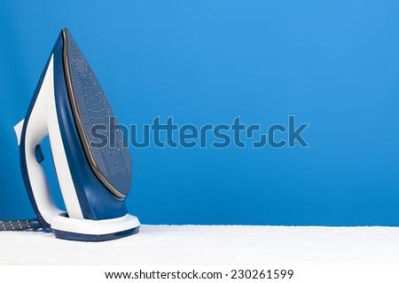 blue iron on blue background - stock photo