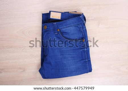 Blue jean on wooden background