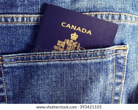 Blue jean pocket with Canadian Passport - stock photo