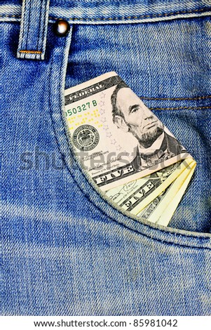 Blue jeans and money in a pocket