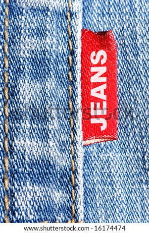 """Blue jeans and red label with word """"Jeans"""" - stock photo"""