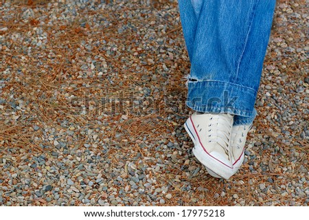 Blue Jeans and White Sneakers - stock photo