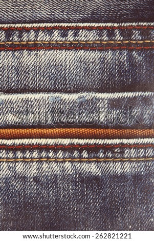 Blue jeans background with seam - stock photo