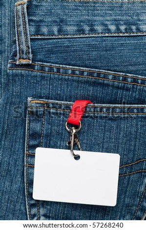 Blue jeans detail with blank badge - stock photo