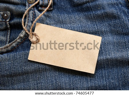 Blue jeans detail with blank tag - stock photo