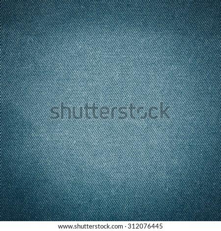 blue jeans fabric texture background, modern denim material texture closeup subtle lines pattern - stock photo