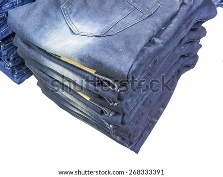 blue jeans folded on isolated background - stock photo