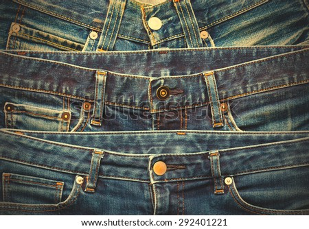 Blue jeans in stack on display in shop. instagram image filter retro style - stock photo