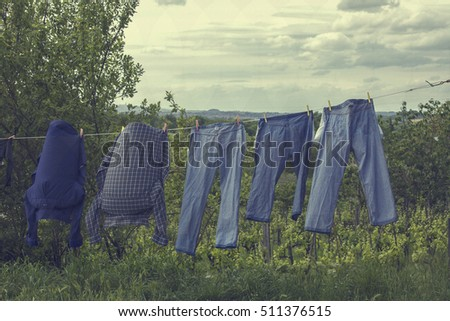 Blue jeans on a clothesline to dry