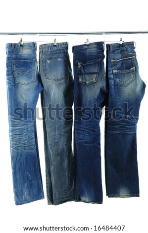 Blue jeans on a hanger - stock photo