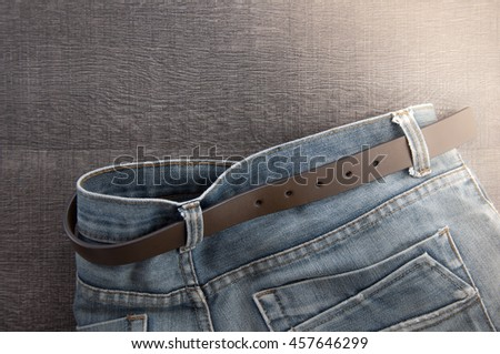Blue jeans on a wooden background.Traveler wear blue jean