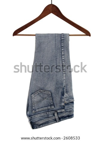 Blue jeans on a wooden hanger - stock photo