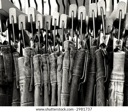 blue jeans on rack - stock photo