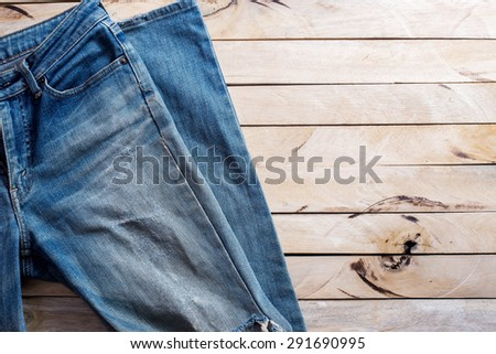 blue jeans on wood background - stock photo