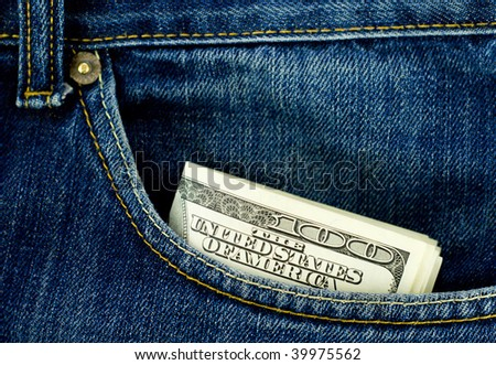 Blue jeans pocket with hundred dollars banknotes - stock photo
