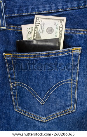 Blue jeans pocket with wallet and dollars