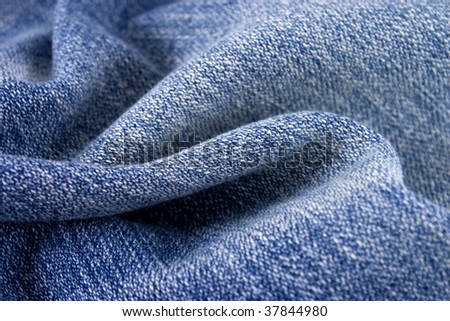 Blue jeans texture ideal for background. - stock photo