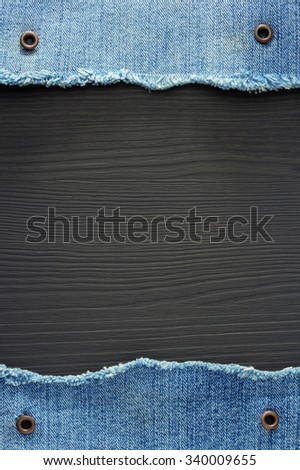 blue jeans texture on wooden background - stock photo