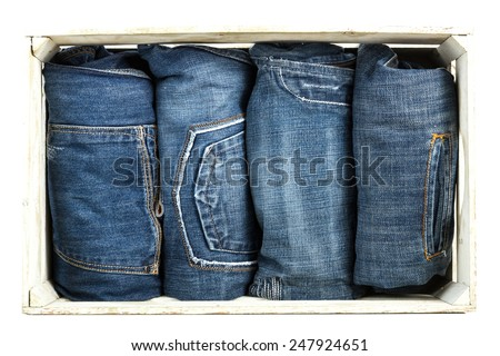 Blue jeans trouser over old grungy wooden box - stock photo