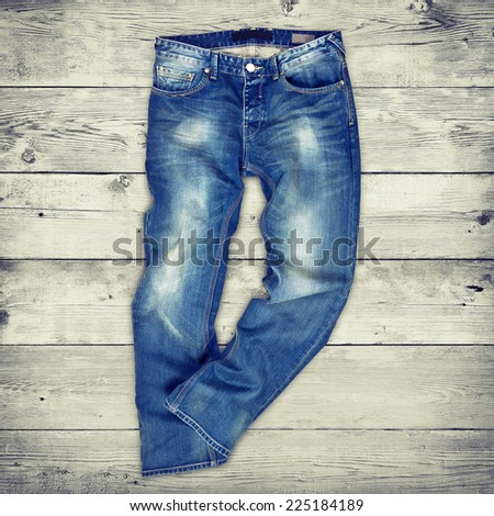 Blue jeans trouser over white wood planks background - stock photo
