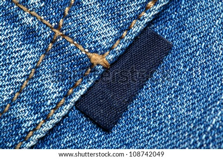 Blue jeans with blank label macro - stock photo