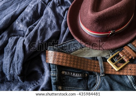 Blue jeans with leather belt and fedora hat - stock photo