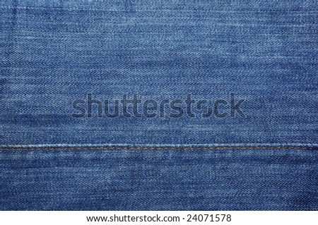 Blue jeans with yellow stitches as textile abstract backdrop or background. - stock photo