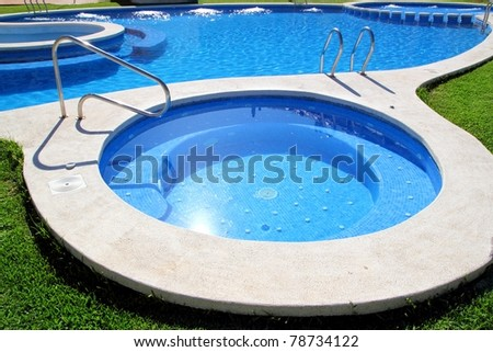 blue jet spa pool in green grass garden outdoor day spa - stock photo