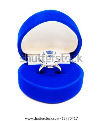 blue jewelry box with ring on white background - stock photo