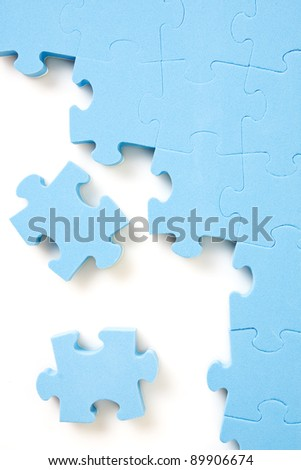 blue jigsaw puzzle pieces on white background - stock photo