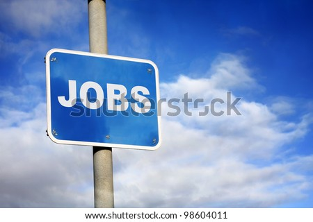 Blue jobs sign against a blue sky - stock photo