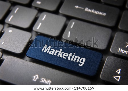 Blue key with marketing text on laptop keyboard. Included clipping path, so you can easily edit it. - stock photo