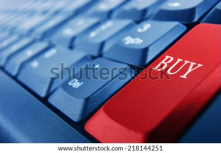 Blue keyboard with red buy button - stock photo
