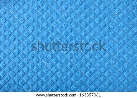 Blue kitchen sponge rubber foam as background texture - stock photo