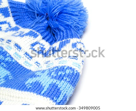 blue knitted baby hat on an isolated background - stock photo