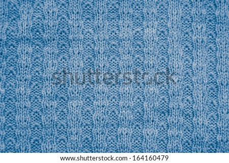 blue knitted fabric as a background. macro - stock photo