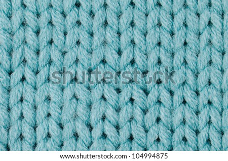 Blue knitted wool texture can use as background. - stock photo
