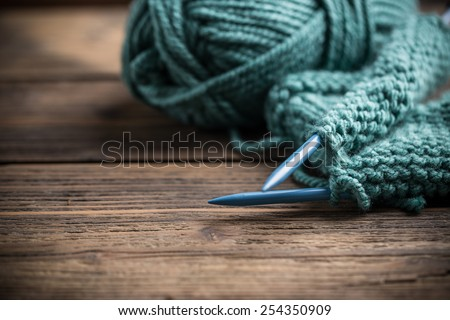Blue knitting wool and knitting needles  - stock photo