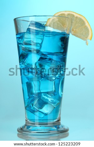 Blue Lagoon cocktail on blue background