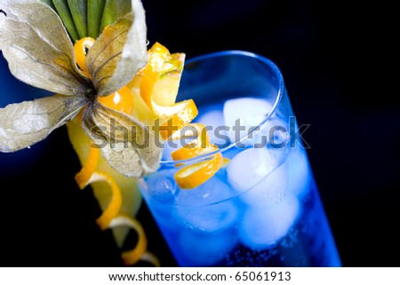 blue lagoon cocktail served in a glass - stock photo