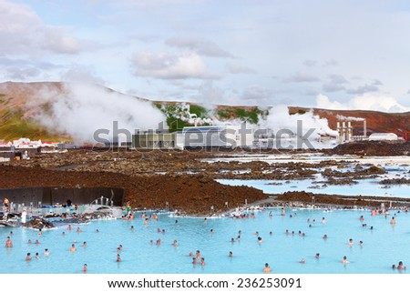 Blue Lagoon, Iceland - August 02, 2014: People bathing in The Blue Lagoon, a geothermal bath resort in the south of Iceland, a 'must see' by tourists, near Reykjavik. August 02, 2014 in Iceland.   - stock photo